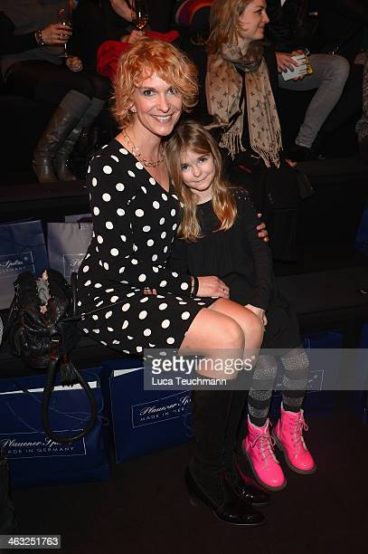 Heike Kloss with Olivia attends the Irene Luft show during MercedesBenz Fashion Week Autumn/Winter 2014/15 at Brandenburg Gate on January 17 2014 in...