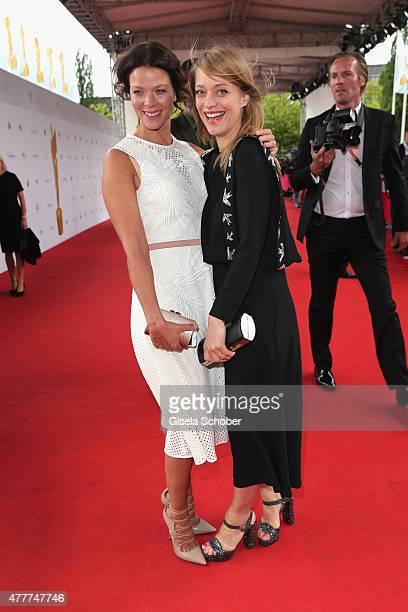 Heike Makatsch and Jessica Schwarz arrive for the German Film Award 2015 Lola at Messe Berlin on June 19, 2015 in Berlin, Germany.