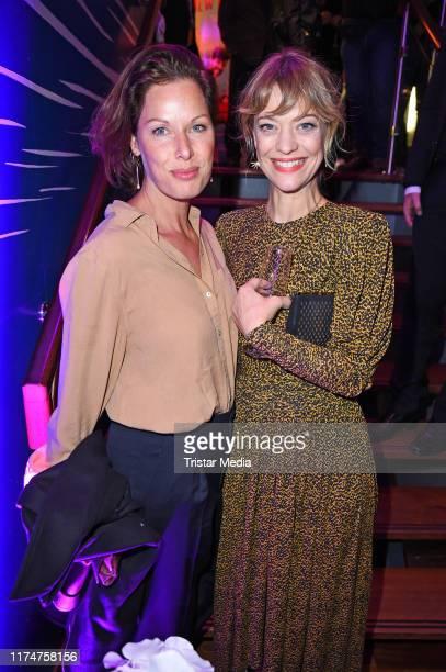"""Heike Makatsch and Sandrine Mittelstaedt attend the world premiere of the movie """"Ich war noch niemals in New York"""" at Cinedom on October 9, 2019 in..."""