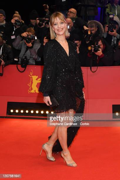 """Heike Makatsch arrives for the opening ceremony and """"My Salinger Year"""" premiere during the 70th Berlinale International Film Festival Berlin at..."""