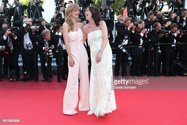CANNES FRANCE MAY 15 Heike Makatsch Iris Berben is wearing a white dress by Talbot Runhof during the From The Land Of The Moon premiere during the...