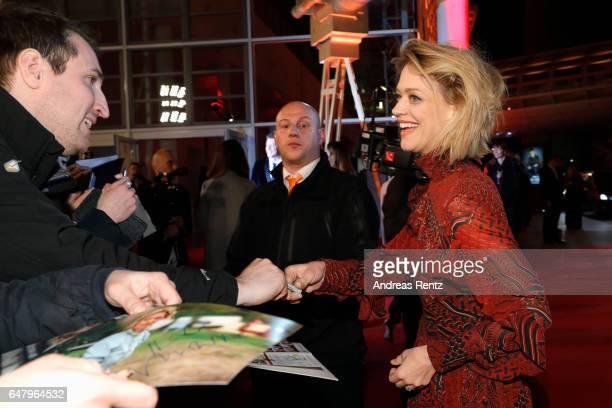 Heike Makatsch sings autographs as she arrives for the Goldene Kamera on March 4, 2017 in Hamburg, Germany.