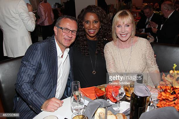 Heike Maurer her husband Ralf Immel and Liz Baffoe attend the CHIO 2014 media night on July 15 2014 in Aachen Germany