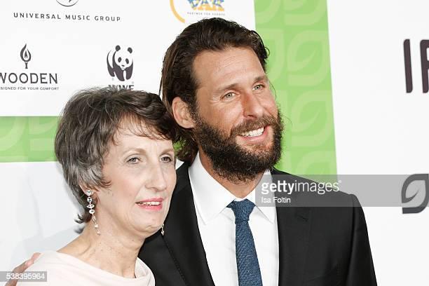 Heike Schiffler and adventurer David Mayer de Rothschild attend the Green Tec Award at ICM Munich on May 29 2016 in Munich Germany
