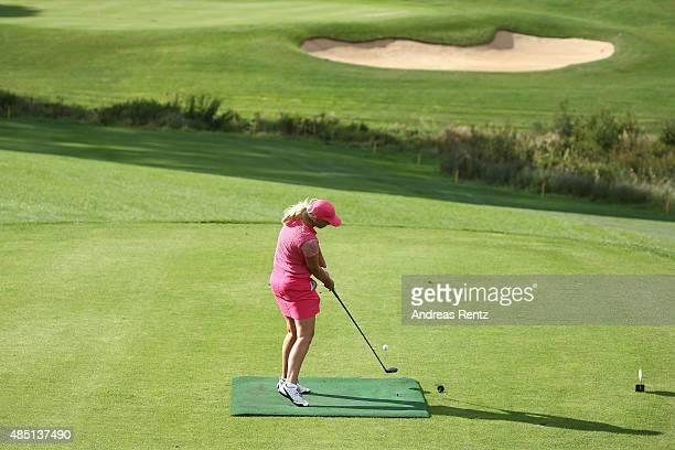 Heike Wontorra hits a tee shot during the 'RTL - Wir helfen Kindern' Golf Charity 2015 tournament at Golf Club Oberberg on August 24, 2015 in...