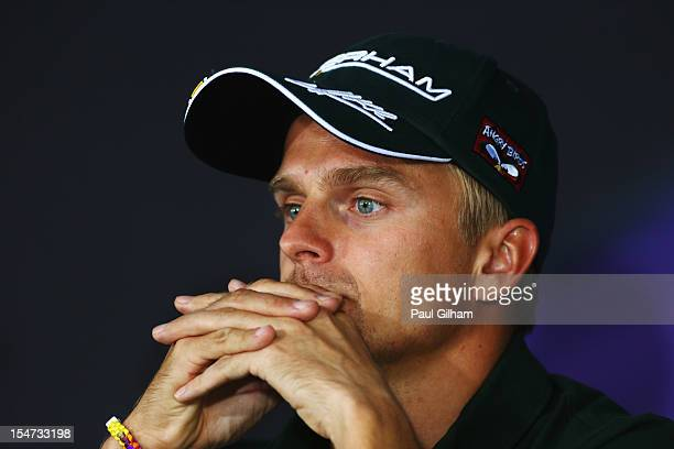 Heikki Kovalainen of Finland and Caterham attends the drivers press conference during previews for the Indian Formula One Grand Prix at Buddh...