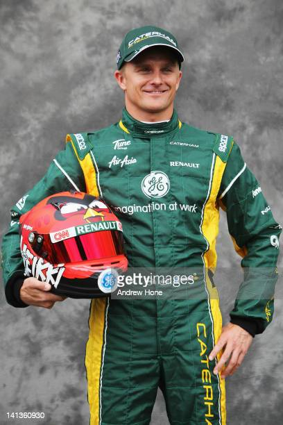 Heikki Kovalainen of Finland and Caterham attends the drivers portrait session during previews to the Australian Formula One Grand Prix at the Albert...