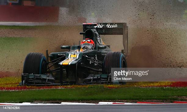 Heikki Kovalainen of Finland and Caterham slids off the track in the wet during practice for the British Grand Prix at Silverstone Circuit on July 6,...
