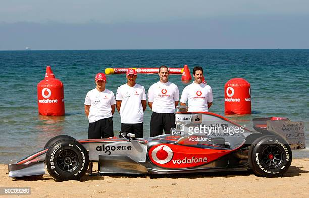 Heikki Kovalainen of Finland and Lewis Hamilton of Great Britain and Vodafone McLaren Mercedes team poses with V8 Supercar drivers Craig Lowndes and...