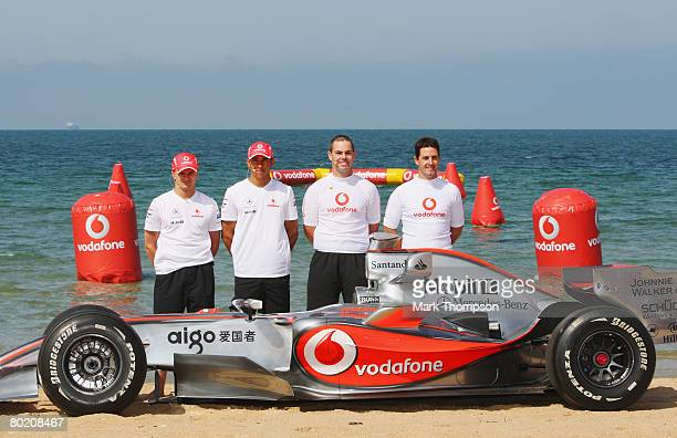 Heikki Kovalainen of Finland and Lewis Hamilton of Great Britain of McLaren Mercedes, and Aussie V8 Supercar drivers Craig Lowndes and Jamie Whincup...