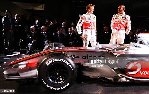 Heikki Kovalainen of Finland and Lewis Hamilton of Great Britain pose during The Vodafone McLaren Mercedes Formula One Grand Prix team launch of the...