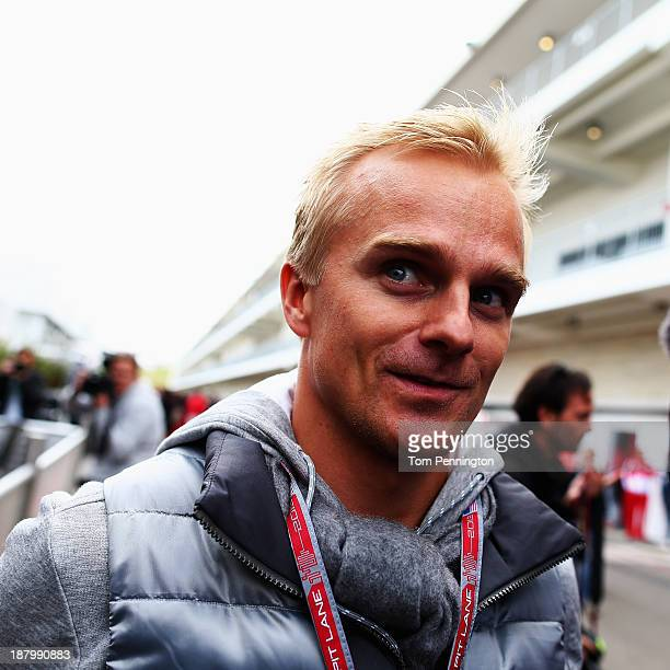 Heikki Kovalainen of Finland and Lotus arrives in the paddock during previews to the United States Formula One Grand Prix at Circuit of The Americas...