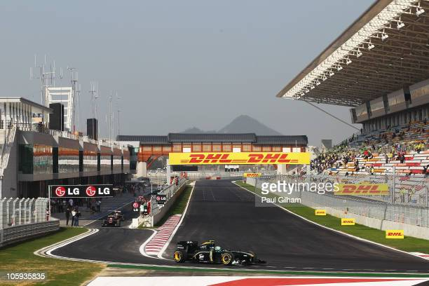 Heikki Kovalainen of Finland and Lotus becomes the first car to take to the new track during practice for the Korean Formula One Grand Prix at the...