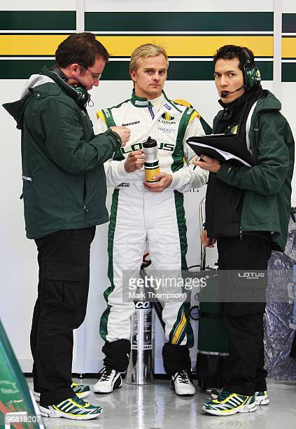 Heikki Kovalainen of Finland and Lotus talks to engineers in his team garage during winter testing at the Circuito De Jerez on February 18 2010 in...
