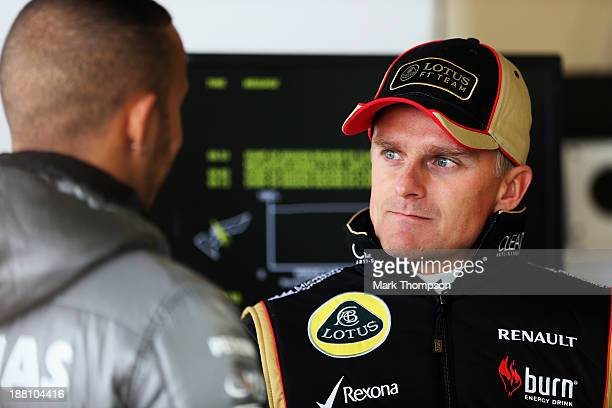 Heikki Kovalainen of Finland and Lotus talks with Lewis Hamilton of Great Britain and Mercedes GP as they prepare to drive during practice for the...