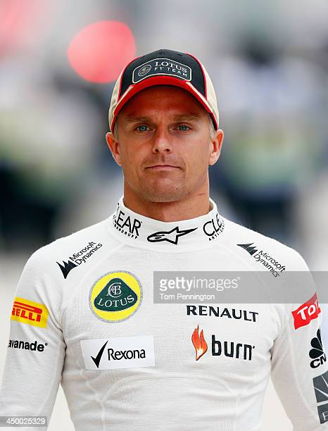 Heikki Kovalainen of Finland and Lotus walks through the pit area during the final practice session prior to qualifying for the United States Formula...