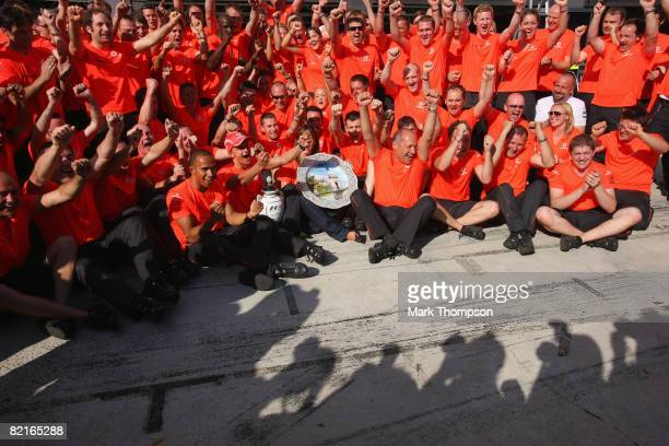 Heikki Kovalainen of Finland and McLaren Mercedes celebrates his victory with team mate Lewis Hamilton,Team Principal Ron Dennis and team members...
