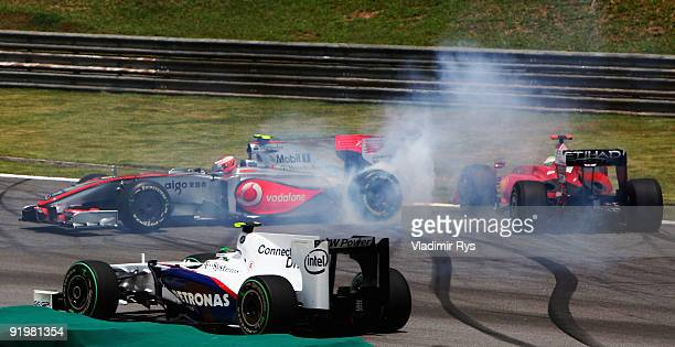 Heikki Kovalainen of Finland and McLaren Mercedes spins on the first lap during the Brazilian Formula One Grand Prix at Interlagos Circuit on October...