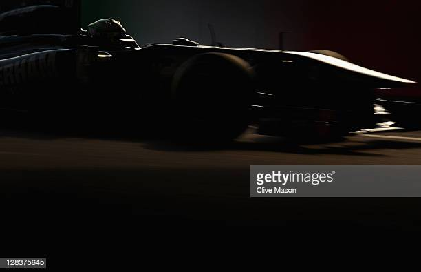 Heikki Kovalainen of Finland and Team Lotus drives during practice for the Japanese Formula One Grand Prix at Suzuka Circuit on October 7, 2011 in...