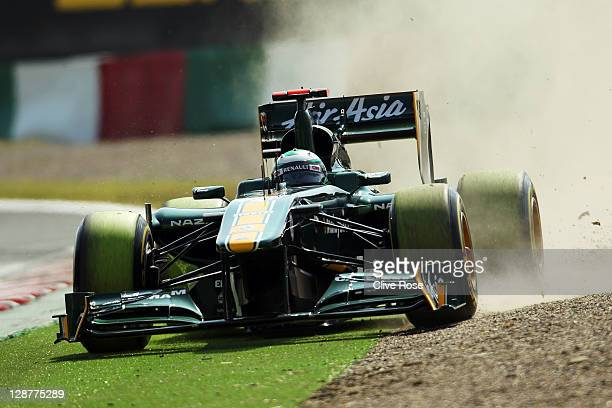 Heikki Kovalainen of Finland and Team Lotus drives off course during the final practice session prior to qualifying for the Japanese Formula One...