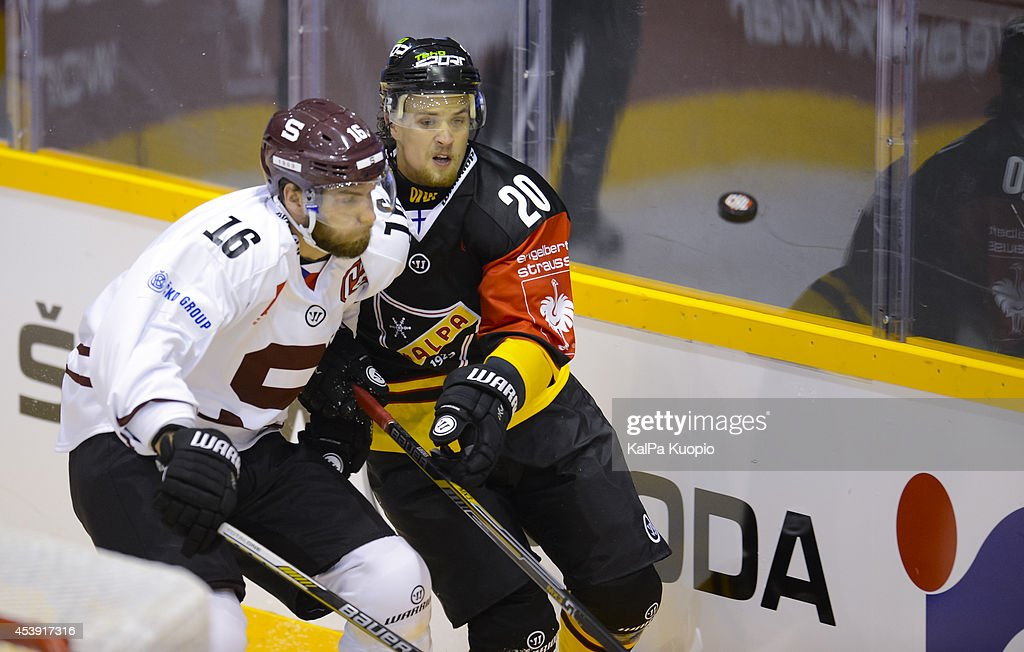 Heikki Liedes #20 prepares to take tackle from Adam Polasek #16 during the Champions Hockey League game between KalPa Kuopio and Sparta Prague at Data Group Areena on August 21, 2014 in Kuopio, Finland.