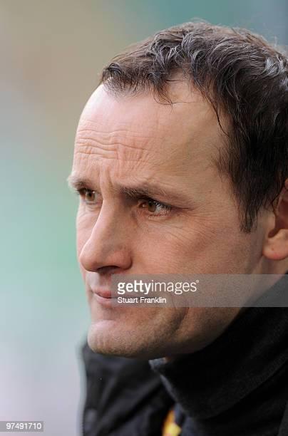 Heiko Herrlich, Head Coach of Bochum ponders during the Bundesliga match between VfL Wolfsburg and VfL Bochum at Volkswagen Arena on March 6, 2010 in...