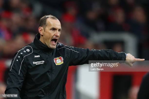 Heiko Herrlich Manager of Bayer 04 Leverkusen gives his team instructions during the Bundesliga match between Bayer 04 Leverkusen and Hertha BSC at...