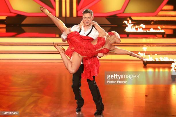 Heiko Lochmann and Kathrin Menzinger perform on stage during the 3rd show of the 11th season of the television competition 'Let's Dance' on April 6...
