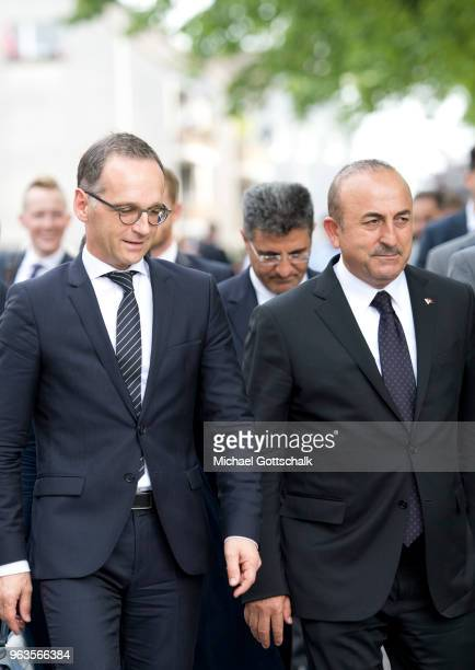 Heiko Maas, Foreign Minister of Germany and Mevlut Cavusoglu, Foreign Minister of Turkey, visit the memorial site of the arson attack on the house of...