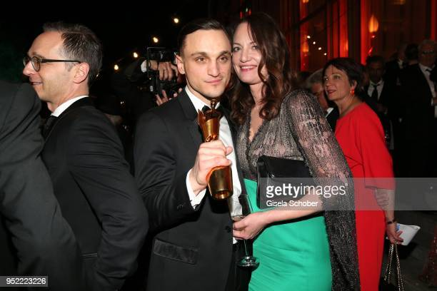 Heiko Maas Franz Rogowski Natalia Woerner during the Lola German Film Award party at Palais am Funkturm on April 27 2018 in Berlin Germany