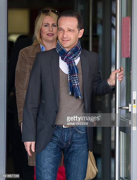 Heiko Maas top candidate of the social demcratic SPD party and his wife Corinna leave a polling station in Saarlouis southwestern Germany during...