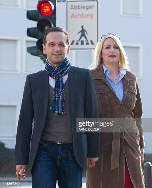 Heiko Maas, top candidate of the social demcratic SPD party, and his wife Corinna leave a polling station in Saarlouis, southwestern Germany, during...