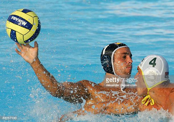 Heiko Nossek of Germany throws the ball over Pietro Figlioli of Australia during the men's preliminary game at the XI FINA World Championships at the...