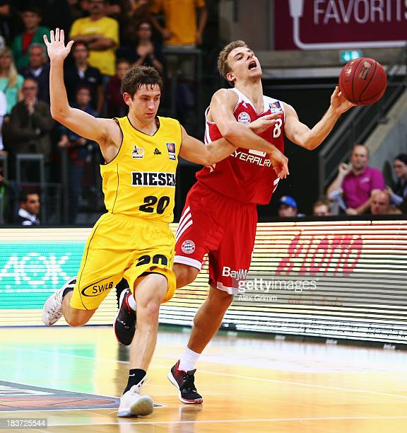 Heiko Schaffartzik of Muenchen is challenged by Michael Stockton of Ludwigsburg during the BBL match between MHP RIESEN Ludwigsburg and Bayern...