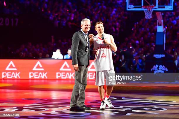 Heiko Schaffartzik with his father after winning the Peak 3Points shootout for the third year running during the All Star Game at AccorHotels Arena...