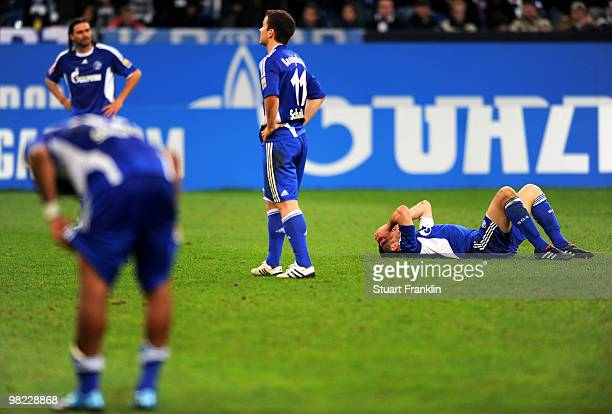 Heiko Westermann and Alexander Baumjohann of Schalke look dejected at the end of the Bundesliga match between FC Schalke 04 and FC Bayern Muenchen at...