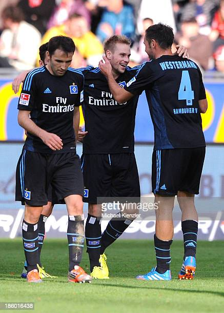 Heiko Westermann and Maximilian Beister of Hamburg celebrate the opening goal of Beister during the Bundesliga match between SC Freiburg and...