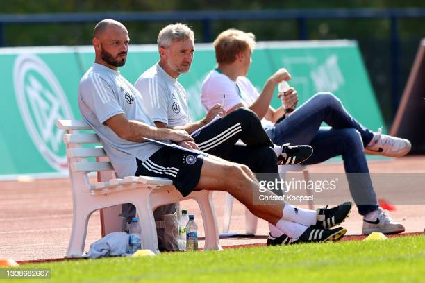 Heiko Westermann, assistant coach and Mario Himsl, assistant coach watch the KOMM MIT U17 Four Nations Tournament match between Germany U17 and Italy...