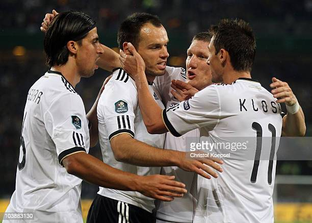 Heiko Westermann celebrates the first goal with Sami Khedira Bastian Schweinsteiger and Miroslav Klose of Germany during the EURO 2012 Group A...
