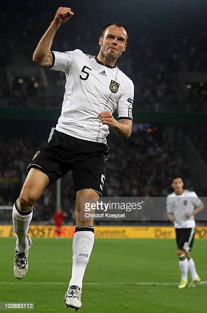 Heiko Westermann of Germany celebrates the first goal during the EURO 2012 Group A Qualifier match between Germany and Azerbaijan at RheinEnergie...
