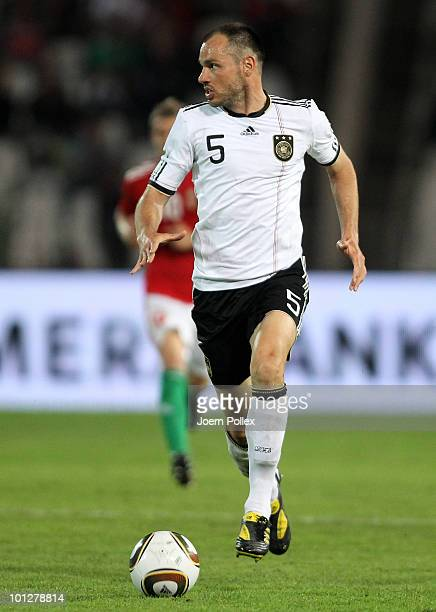 Heiko Westermann of Germany runs with the ball during the international friendly match between Hungary and Germany at the Ferenc Puskas Stadium on...