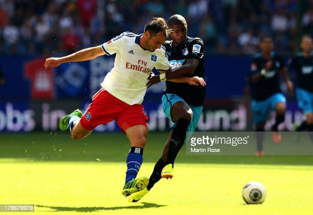 Heiko Westermann of Hamburg and Anthony Modeste of Hoffenheim battle for the ball during the Bundesliga match between Hamburger Sv and 1899...