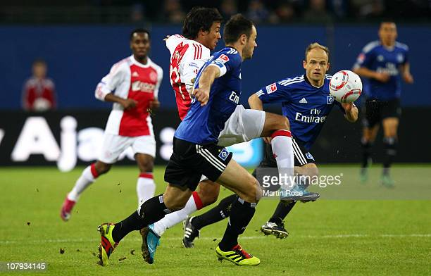 Heiko Westermann of Hamburg and Dario Cvitanich of Amsterdam battle for the ball during the friendly match between Hamburger SV and Ajax Amsterdam at...