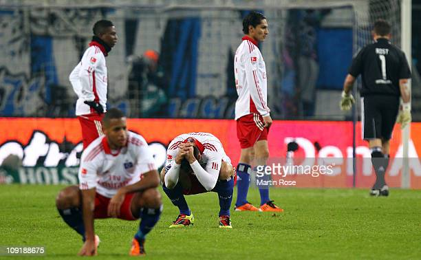 Heiko Westermann of Hamburg and his team mates look dejected after the Bundesliga match between Hamburger SV and FC StPauli at Imtech Arena on...