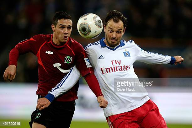 Heiko Westermann of Hamburg and Maunel Schmiedebach of Hannover compete for the ball during the Bundesliga match between Hamburger SV and Hannover 96...