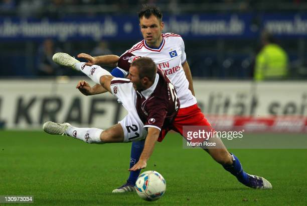 Heiko Westermann of Hamburg and Pierre de Wit of Kaiserslautern battle for the ball during the Bundesliga match between Hamburger SV and 1 FC...