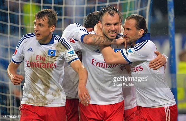 Heiko Westermann of Hamburg celebrates scoring his goal during the Bundesliga match between Hamburger SV and Bayer Leverkusen at Imtech Arena on...