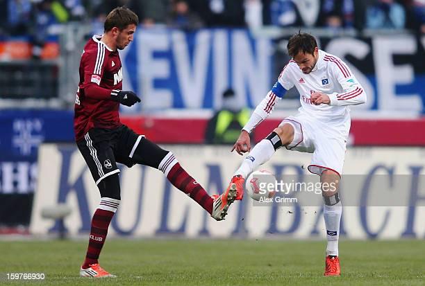 Heiko Westermann of Hamburg is challenged by Tomas Pekarik of Nuernberg during the Bundesliga match between 1 FC Nuernberg and Hamburger SV at Easy...