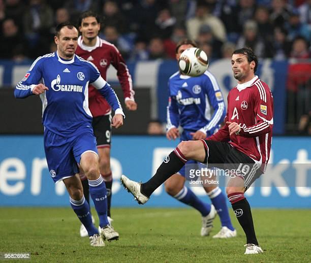 Heiko Westermann of Schalke and Albert Bunjaku of Nuernberg battle for the ball during the Bundesliga match between FC Schalke 04 and 1 FC Nuernberg...