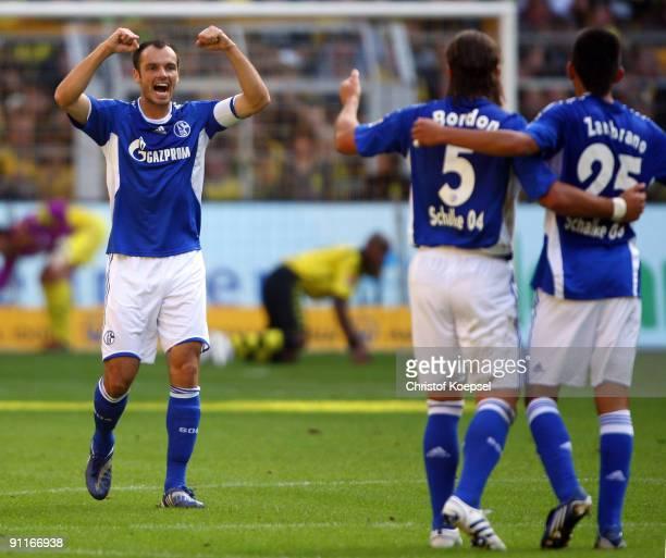 Heiko Westermann of Schalke celebrates scoring his team's first goal during the Bundesliga match between Borussia Dortmund and FC Schalke 04 at the...